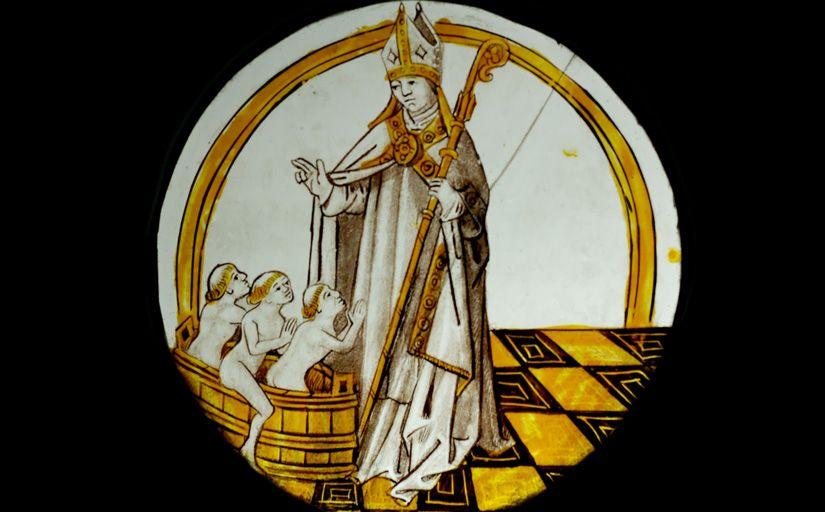 Nicolau de Mira amb tres nens que havia salvat