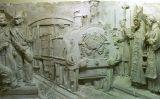 'La benedicció del tren', un relleu que es conserva al Museu de Mataró i que representa la benedicció d'una de les locomotores de la primera línia de ferrocarril de la Península